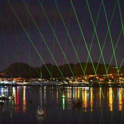 Lasers pulsing Thank You into the estuary and heavens